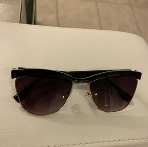 Free people London sunglasses. FP written on arm.